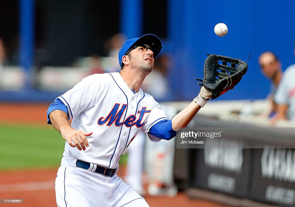 Josh Satin #13 of the New York Mets makes a catch for an out in the eighth inning against the Philadelphia Phillies at Citi Field on July 21, 2013 in the Flushing neighborhood of the Queens borough of New York City.