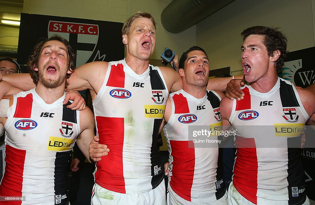 Josh Saunders, Nick Riewoldt, Leigh Montagna and Lenny Hayes of the Saints sing the song in the rooms after winning the round five AFL match between the Essendon Bombers and the St Kilda Saints at Etihad Stadium on April 19, 2014 in Melbourne, Australia.