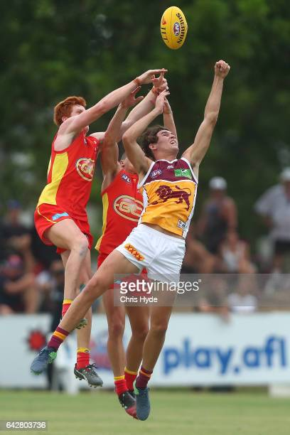 Josh Schoefeld of the Suns and Jacob Allison of the Lions compete for the ball during the 2017 JLT Community Series match at Broadbeach Sports Centre...