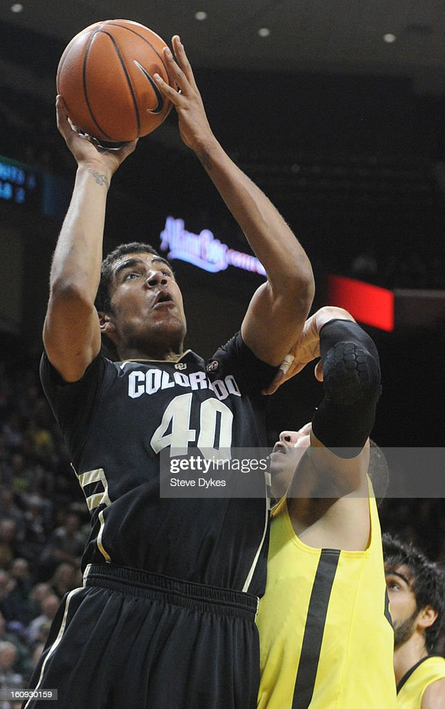 Josh Scott #40 of the Colorado Buffaloes drives to the basket on Waverly Austin #20 of the Oregon Ducks in the half of the game at Matthew Knight Arena on February 7, 2013 in Eugene, Oregon. Colorado won the game 48-47.