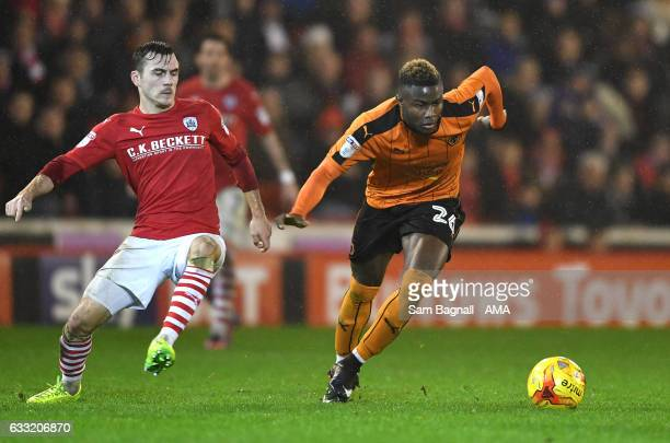 Josh Scowen of Barnsley and Bright Enobakhare of Wolverhampton Wanderers during the Sky Bet Championship match between Barnsley and Wolverhampton...