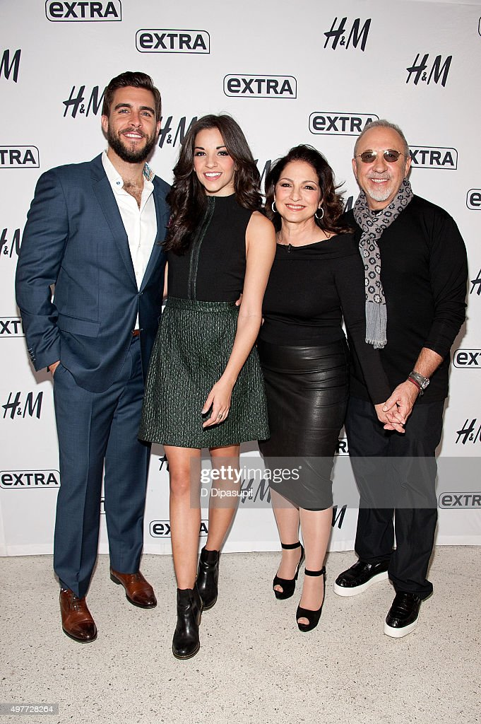Josh Segarra, Ana Villafane, Gloria Estefan, and Emilio Estefan visit 'Extra' at their New York Studios at H&M in Times Square on November 18, 2015 in New York City.