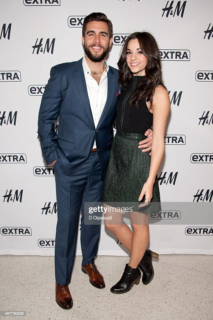 Josh Segarra (L) and Ana Villafane visit 'Extra' at their New York Studios at H&M in Times Square on November 18, 2015 in New York City.