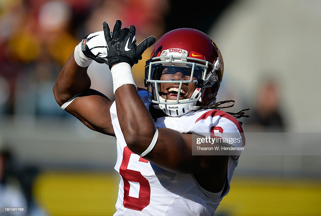 Josh Shaw #6 of the USC Trojans celebrates after returning a blocked punt for a touchdown against the California Golden Bears during the second quarter at California Memorial Stadium on November 9, 2013 in Berkeley, California.