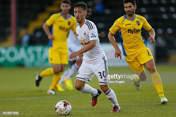 Josh Sheehan of Swansea City in action during the pre season friendly match between Exeter City and Swansea City at St James Park on July 29 2014 in...