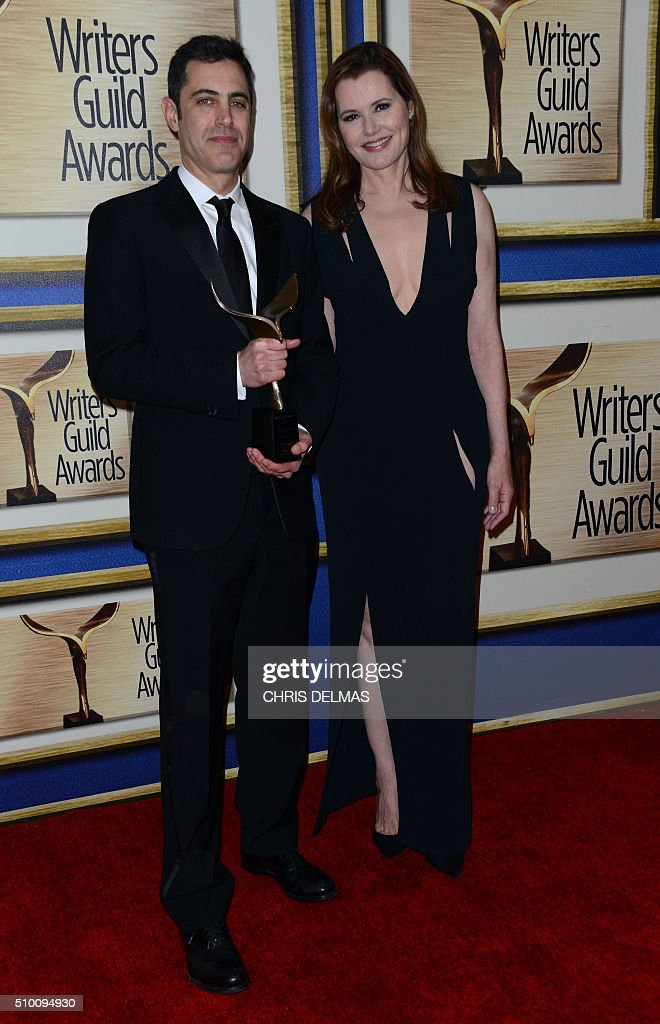 Josh Singer and Geena Davis poses in the press room at the Writers Guild Awards, in Century City, California, February 13, 2016. / AFP / CHRIS DELMAS