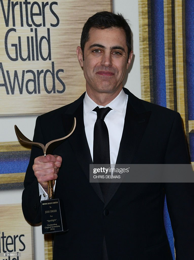 Josh Singer poses in the press room at the Writers Guild Awards, in Century City, California, February 13, 2016. / AFP / CHRIS DELMAS