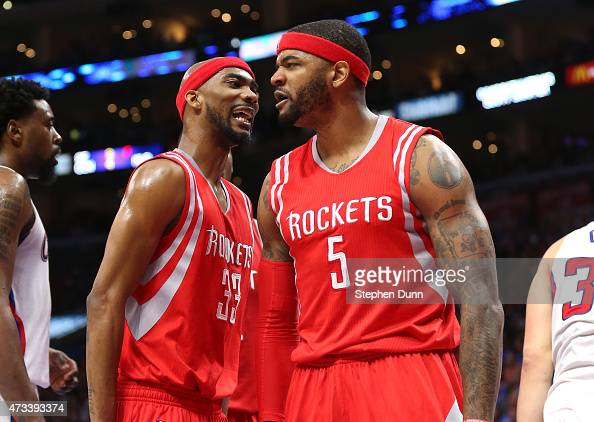 Josh Smith and Corey Brewer of the Houston Rockets celebrates after Smith blocked a shot by Blake Griffin of the Los Angeles Clippers in the fourth...