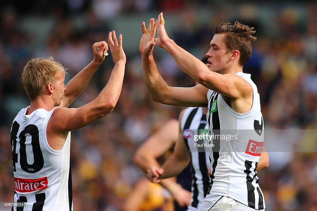 Josh Smith and Matthew Goodyear of the Magpies celebrate a goal during the round six AFL match between the West Coast Eagles and the Collingwood Magpies at Domain Stadium on May 1, 2016 in Perth, Australia.