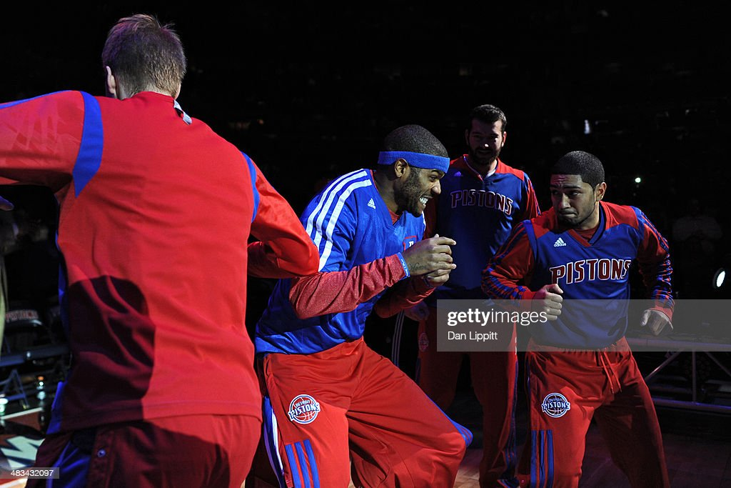 Josh Smith #6 and Peyton Siva #34 of the Detroit Pistons warm up before the game against the New York Knicks on November 19, 2013 at The Palace of Auburn Hills in Auburn Hills, Michigan.