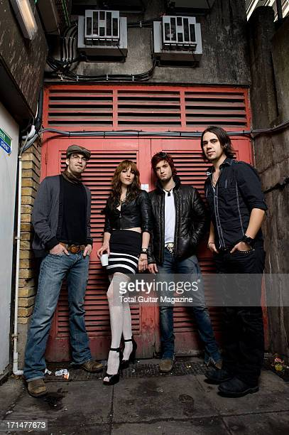 Josh Smith Lzzy Hale Arejay Hale and Joe Hottinger of American rock band Halestorm photographed during a portrait shoot for Total Guitar Magazine...