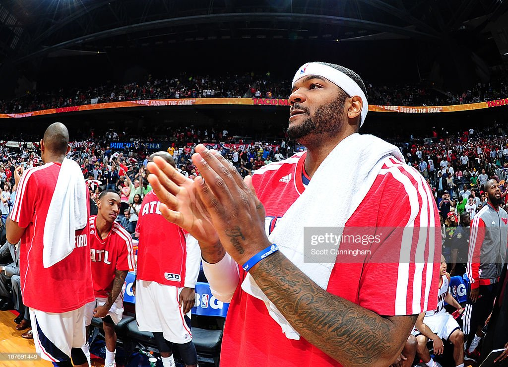 Josh Smith #5 of the Atlanta Hawks applauds during the Game Three of the Eastern Conference Quarterfinals between the Indiana Pacers and the Atlanta Hawks in the 2013 NBA Playoffs on April 27, 2013 at Philips Arena in Atlanta, Georgia.