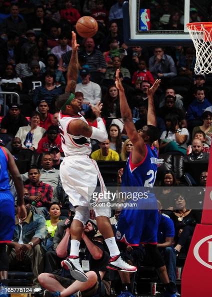 Josh Smith of the Atlanta Hawks attempts a hook shot against Thaddeus Young of the Philadelphia 76ers on April 5 2013 at Philips Arena in Atlanta...