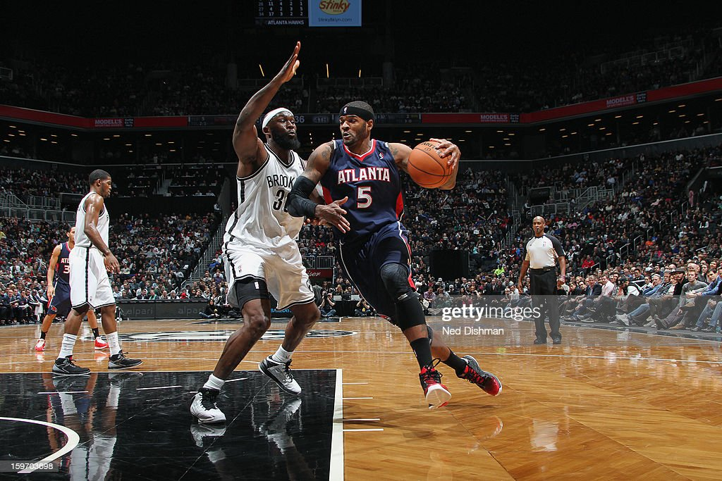 Josh Smith #5 of the Atlanta Hawks attempts a layup against Reggie Evans #10 of the Brooklyn Nets at the Barclays Center on January 18, 2013 in the Brooklyn borough of New York City in New York City.