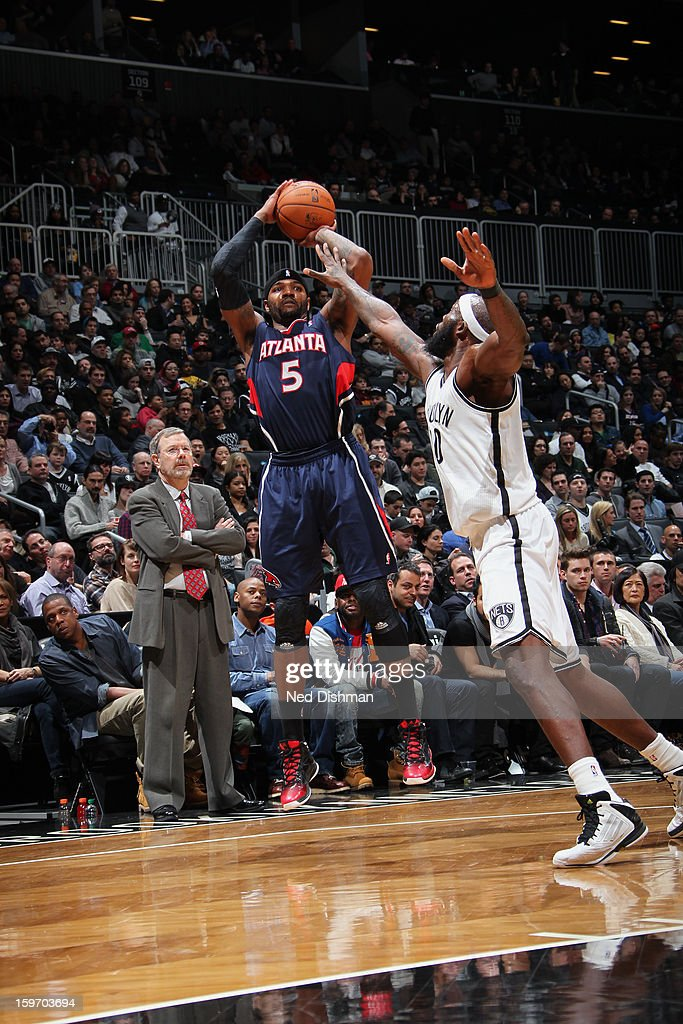 Josh Smith #5 of the Atlanta Hawks attempts a three point shot against Reggie Evans #10 of the Brooklyn Nets at the Barclays Center on January 18, 2013 in the Brooklyn borough of New York City in New York City.