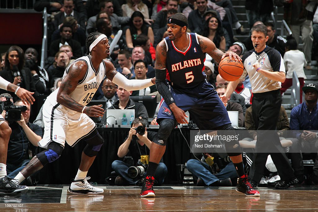 Josh Smith #5 of the Atlanta Hawks backs up to the hoop against Gerald Wallace #45 of the Brooklyn Nets at the Barclays Center on January 18, 2013 in the Brooklyn borough of New York City in New York City.