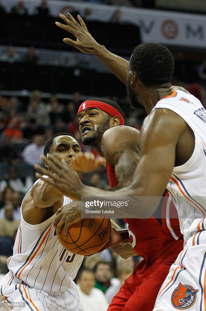 Josh Smith #5 of the Atlanta Hawks battles for the ball with Gerald Henderson #15 of the Charlotte Bobcats during their game at Time Warner Cable Arena on January 6, 2012 in Charlotte, North Carolina.