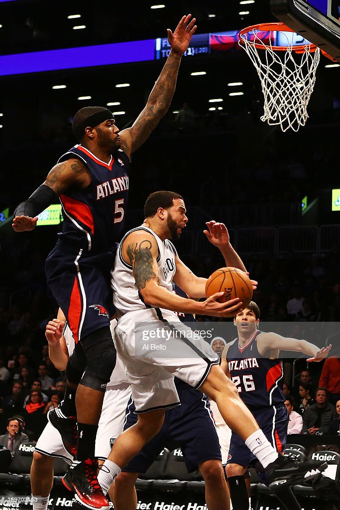 Josh Smith #5 of the Atlanta Hawks blocks a shot by Deron Williams #8 of the Brooklyn Nets in the third quarter of the game at Barclays Center on January 18, 2013 in the Brooklyn borough of New York City.