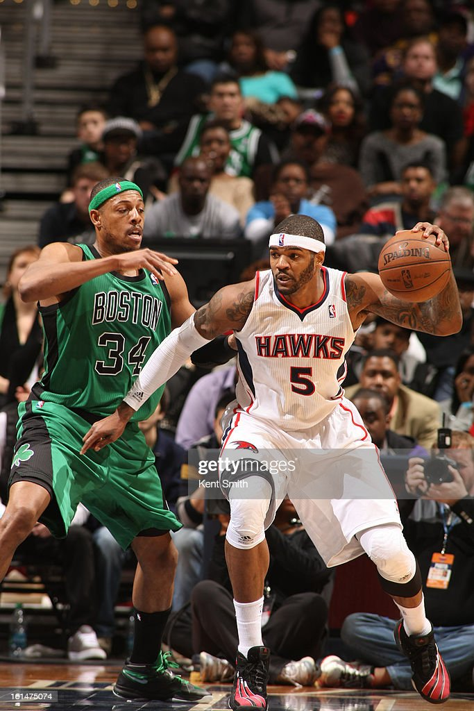 Josh Smith #5 of the Atlanta Hawks dribbles the ball against Paul Pierce #34 of the Boston Celtics at the Philips Arena on January 25, 2013 in Atlanta, Georgia.
