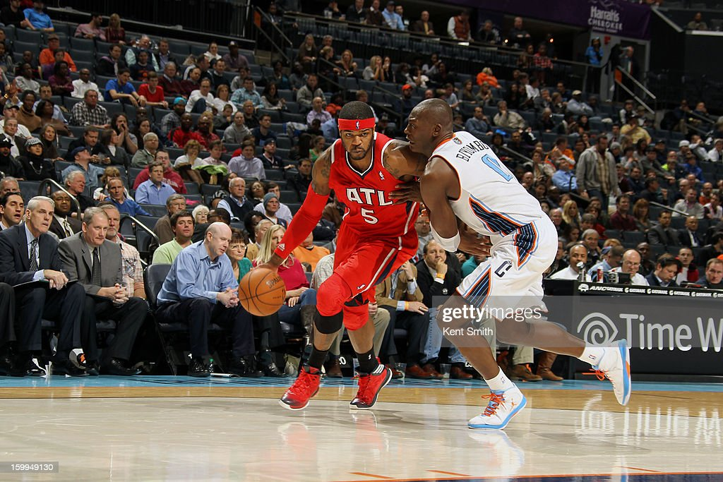 Josh Smith #5 of the Atlanta Hawks drives against Bismack Biyombo #0 of the Charlotte Bobcats at the Time Warner Cable Arena on January 23, 2013 in Charlotte, North Carolina.