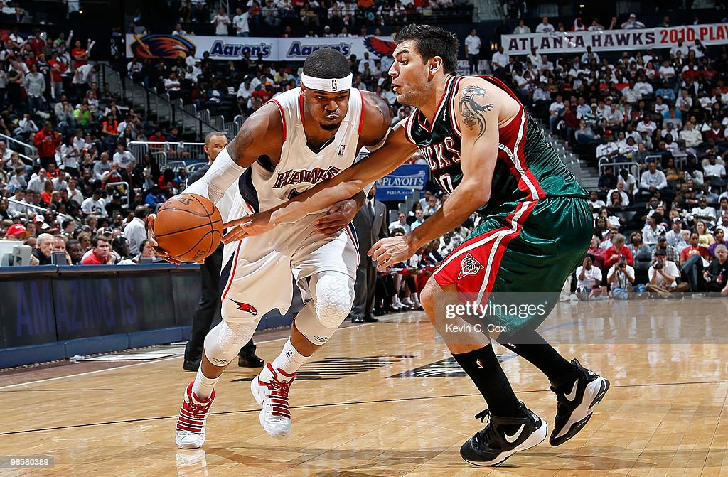 Josh Smith #5 of the Atlanta Hawks drives against Carlos Delfino #10 of the Milwaukee Bucks at Philips Arena on April 20, 2010 in Atlanta, Georgia.