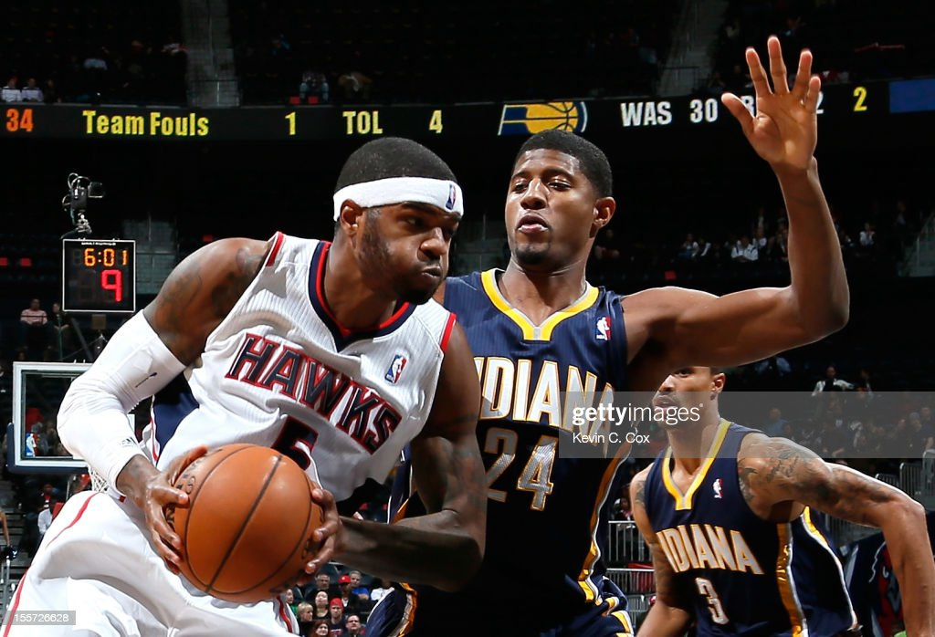 Josh Smith #5 of the Atlanta Hawks drives against Paul George #24 of the Indiana Pacers at Philips Arena on November 7, 2012 in Atlanta, Georgia.