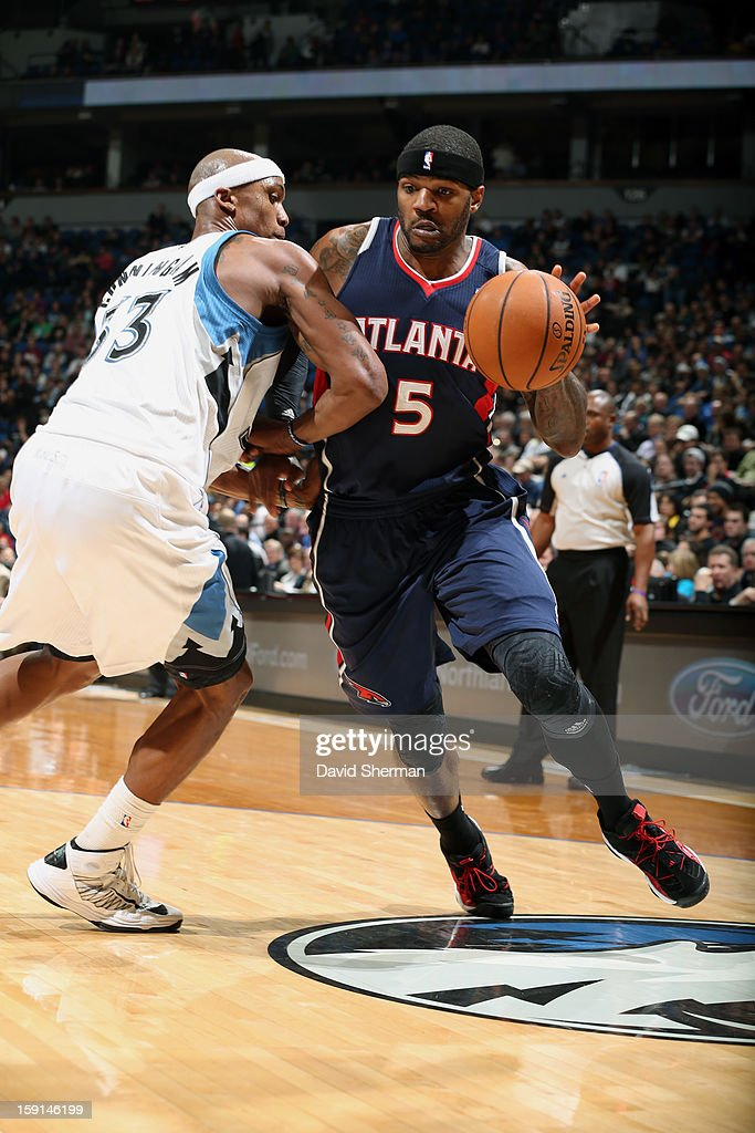Josh Smith #5 of the Atlanta Hawks drives to the basket against Dante Cunningham #33 of the Minnesota Timberwolves during the game on January 8, 2013 at Target Center in Minneapolis, Minnesota.
