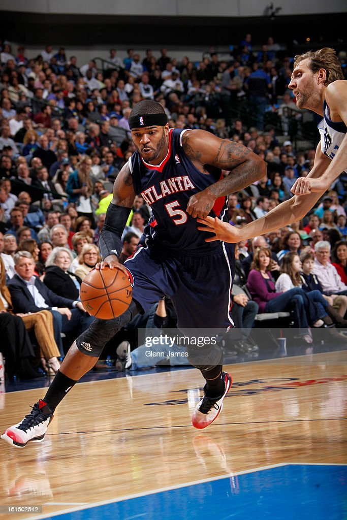Josh Smith #5 of the Atlanta Hawks drives to the basket against the Dallas Mavericks on February 11, 2013 at the American Airlines Center in Dallas, Texas.