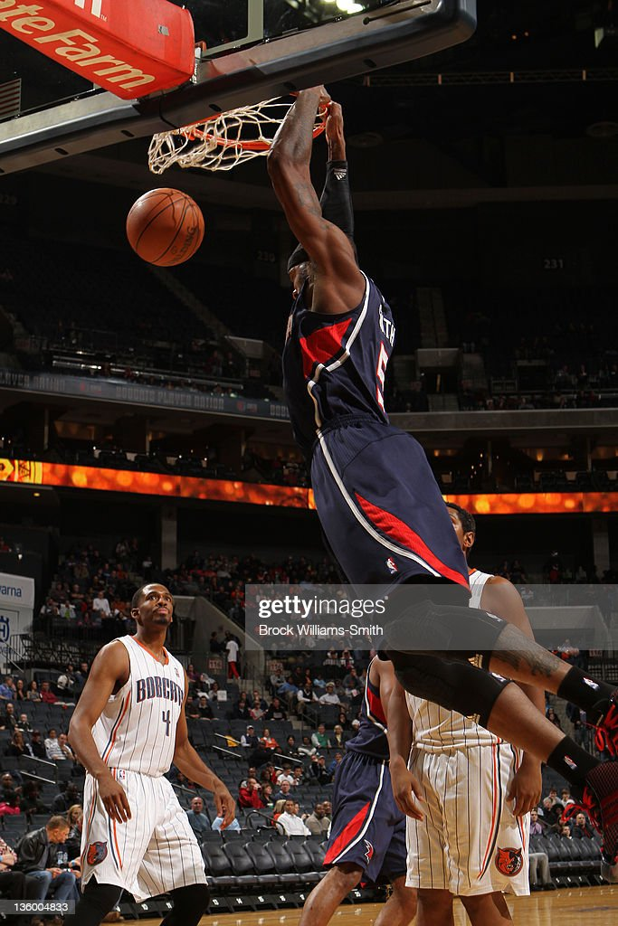 Josh Smith #5 of the Atlanta Hawks dunks against the Charlotte Bobcats on December 19, 2011 during the preseason game at the Time Warner Cable Arena in Charlotte, North Carolina.