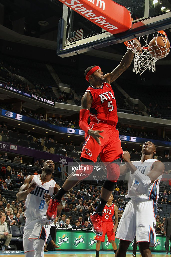 Josh Smith #5 of the Atlanta Hawks dunks against the Charlotte Bobcats at the Time Warner Cable Arena on January 23, 2013 in Charlotte, North Carolina.