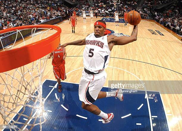 Josh Smith of the Atlanta Hawks dunks against the Houston Rockets at Philips Arena on March 12 2008 in Atlanta Georgia NOTE TO USER User expressly...