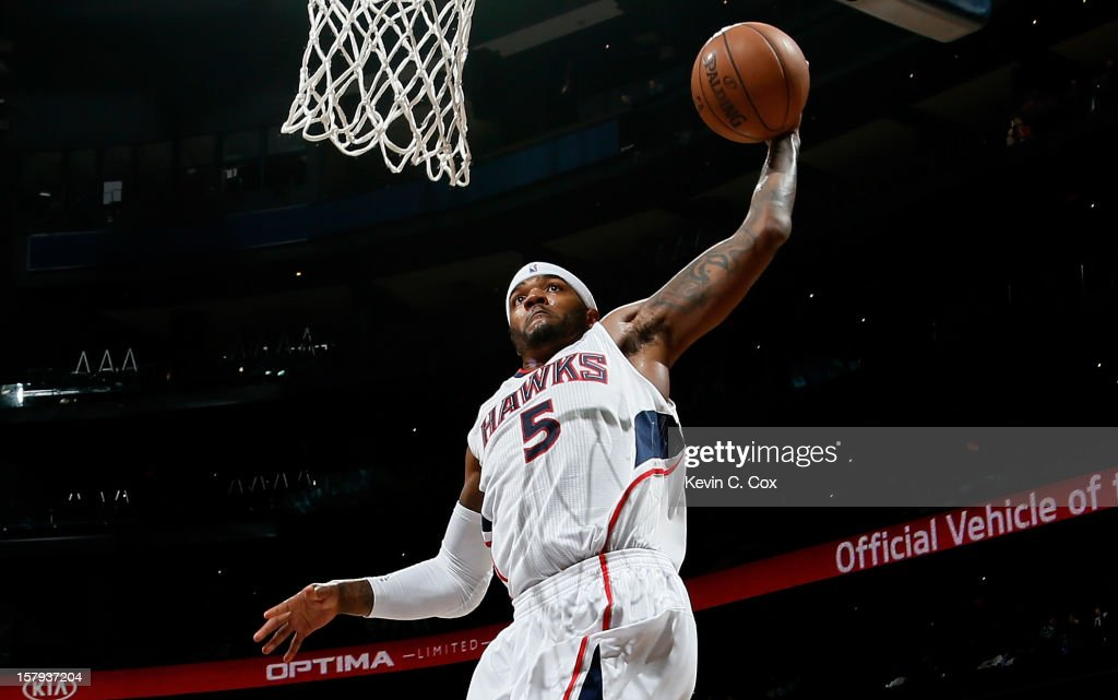 <a gi-track='captionPersonalityLinkClicked' href=/galleries/search?phrase=Josh+Smith+-+Basketball+Player+-+Born+1985&family=editorial&specificpeople=201983 ng-click='$event.stopPropagation()'>Josh Smith</a> #5 of the Atlanta Hawks dunks against the Washington Wizards at Philips Arena on December 7, 2012 in Atlanta, Georgia.