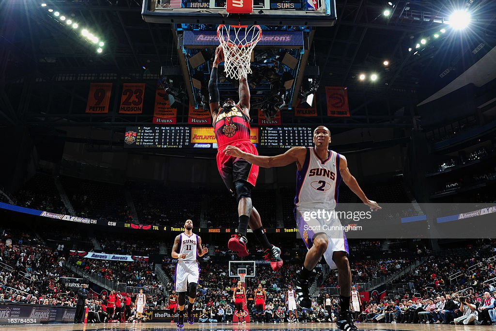 Josh Smith #5 of the Atlanta Hawks dunks the ball against the Phoenix Suns on March 15, 2013 at Philips Arena in Atlanta, Georgia.