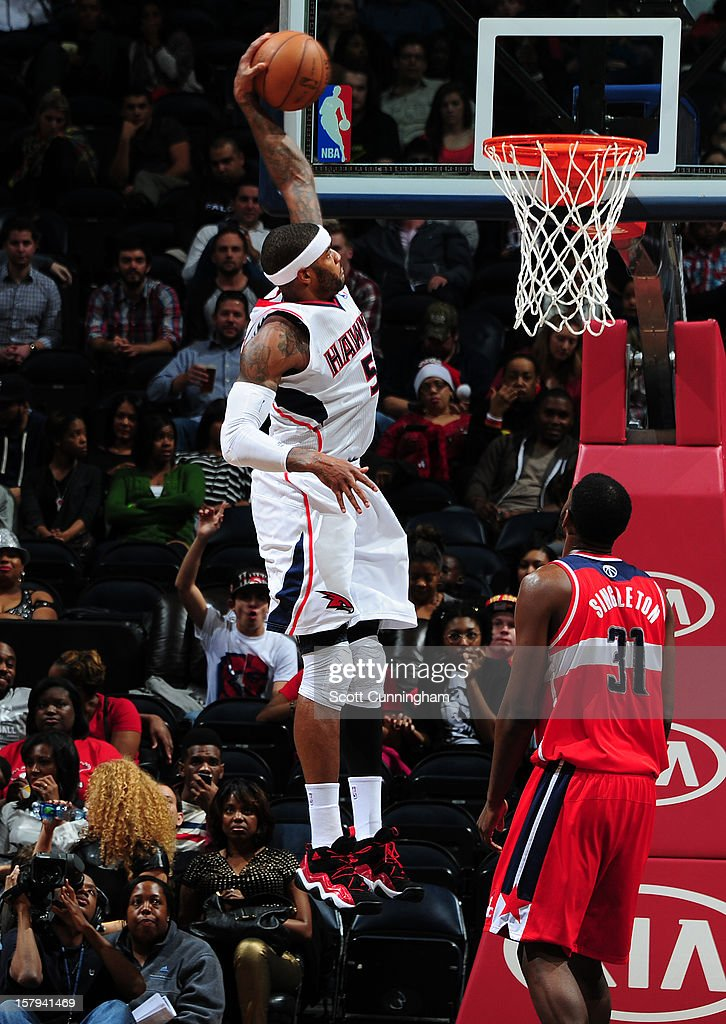 <a gi-track='captionPersonalityLinkClicked' href=/galleries/search?phrase=Josh+Smith+-+Basketball+Player+-+Born+1985&family=editorial&specificpeople=201983 ng-click='$event.stopPropagation()'>Josh Smith</a> #5 of the Atlanta Hawks dunks the ball against the Washington Wizards at Philips Arena on December , 2012 in Atlanta, Georgia.