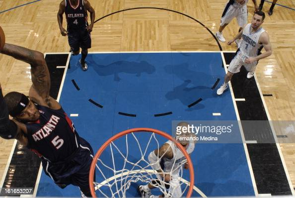 Josh Smith of the Atlanta Hawks gets ready to dunk the ball hard against the Orlando Magic during the game on February 13 2013 at Amway Center in...