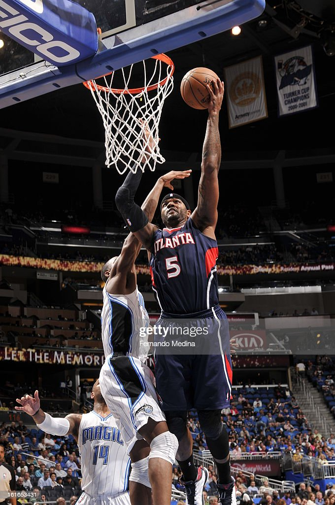 Josh Smith #5 of the Atlanta Hawks goes up for the easy shot against the Orlando Magic during the game on February 13, 2013 at Amway Center in Orlando, Florida.