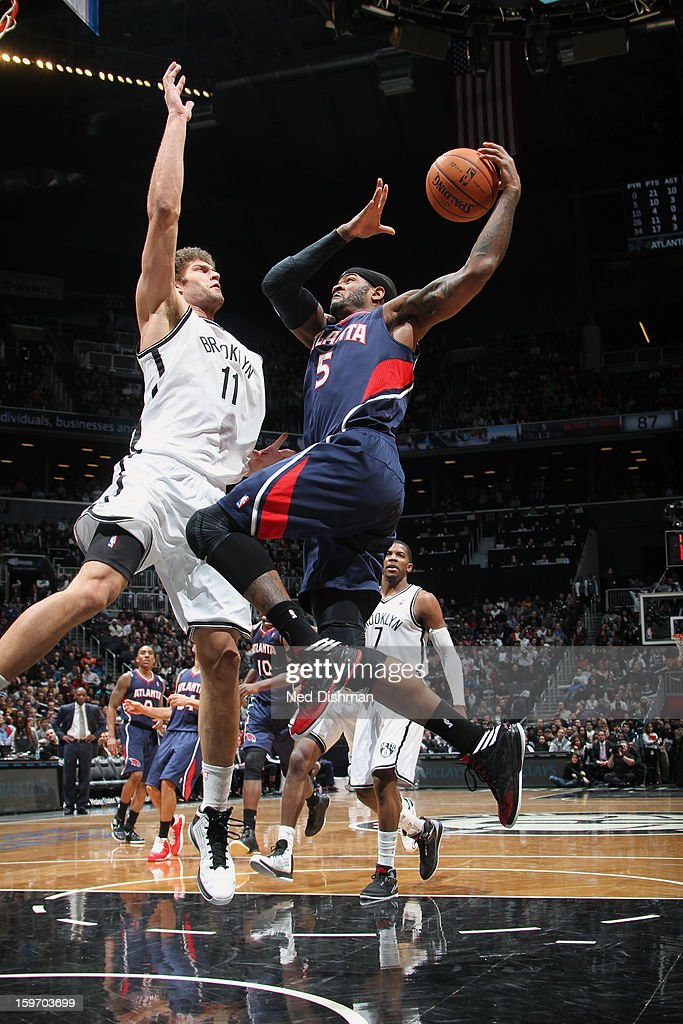 Josh Smith #5 of the Atlanta Hawks goes up for the layup against Brook Lopez #11 of the Brooklyn Nets at the Barclays Center on January 18, 2013 in the Brooklyn borough of New York City in New York City.