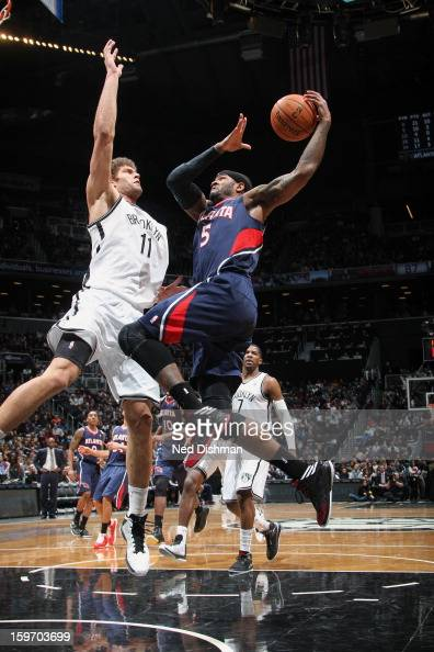 Josh Smith of the Atlanta Hawks goes up for the layup against Brook Lopez of the Brooklyn Nets at the Barclays Center on January 18 2013 in the...
