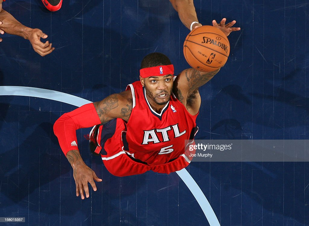 <a gi-track='captionPersonalityLinkClicked' href=/galleries/search?phrase=Josh+Smith+-+Basketball+Player+-+Born+1985&family=editorial&specificpeople=201983 ng-click='$event.stopPropagation()'>Josh Smith</a> #5 of the Atlanta Hawks grabs a rebound against the Memphis Grizzlies on December 8, 2012 at FedExForum in Memphis, Tennessee.