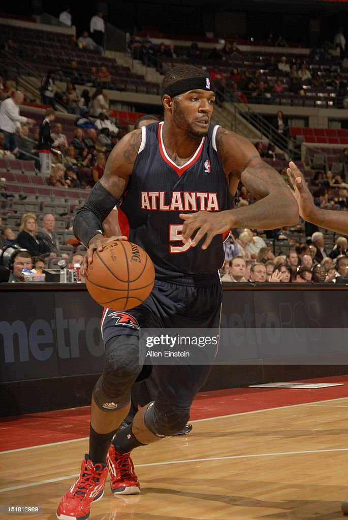 <a gi-track='captionPersonalityLinkClicked' href=/galleries/search?phrase=Josh+Smith+-+Basketball+Player+-+Born+1985&family=editorial&specificpeople=201983 ng-click='$event.stopPropagation()'>Josh Smith</a> #5 of the Atlanta Hawks handles the ball against the Detroit Pistons on October 26, 2012 at The Palace of Auburn Hills in Auburn Hills, Michigan.