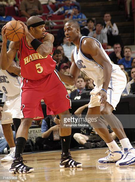 Josh Smith of the Atlanta Hawks holds the ball away from Dwight Howard of the Orlando Magic April 10 2006 at TD Waterhouse Centre in Orlando Florida...