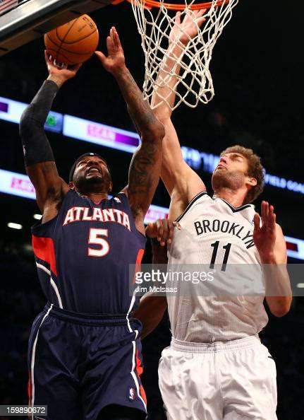 Josh Smith of the Atlanta Hawks in action against Brook Lopez of the Brooklyn Nets at Barclays Center on January 18 2013 in the Brooklyn borough of...