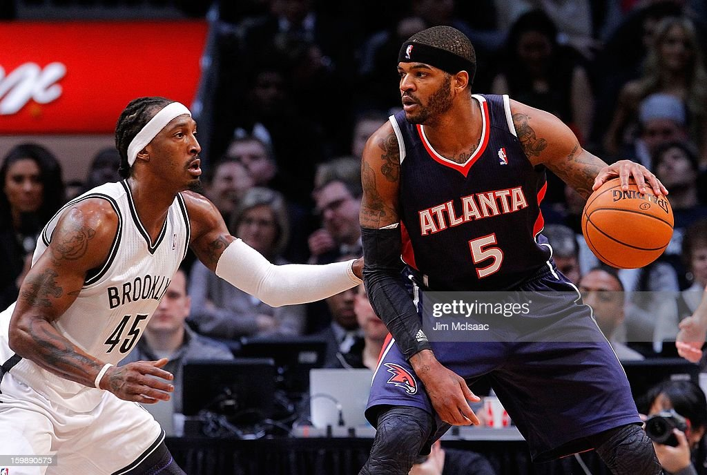Josh Smith #5 of the Atlanta Hawks in action against Gerald Wallace #45 of the Brooklyn Nets at Barclays Center on January 18, 2013 in the Brooklyn borough of New York City.The Nets defeated the Hawks 94-89.