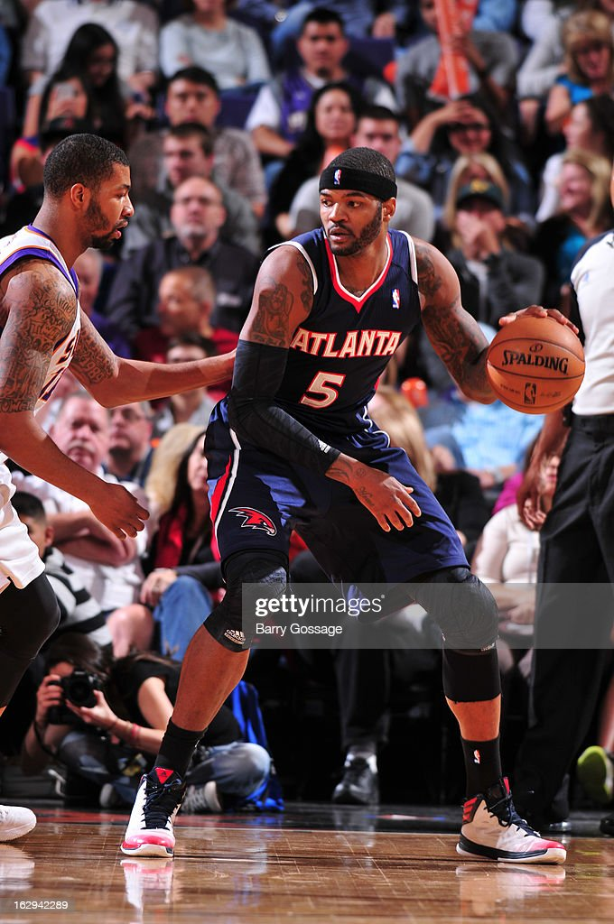 Josh Smith #5 of the Atlanta Hawks is guarded by Markieff Morris #11 of the Phoenix Suns on March 1, 2013 at U.S. Airways Center in Phoenix, Arizona.