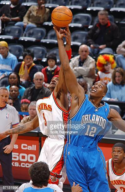 Josh Smith of the Atlanta Hawks jumps against Dwight Howard of the Orlando Magic for the opening tipoff on March 19 2006 at Philips Arena in Atlanta...