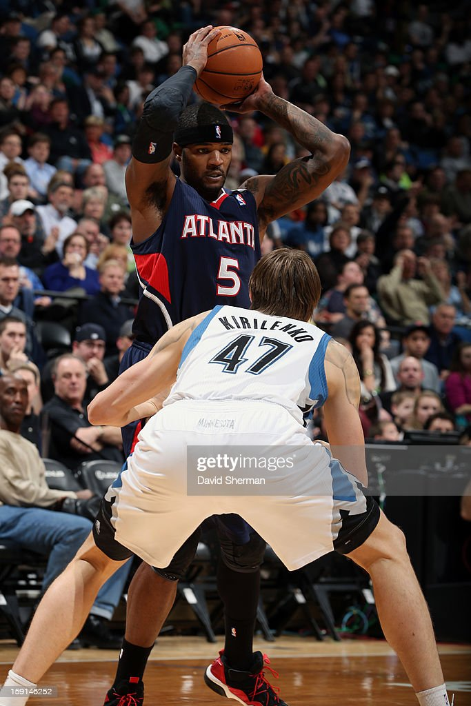 Josh Smith #5 of the Atlanta Hawks looks to pass against Andrei Kirilenko #47 of the Minnesota Timberwolves during the game on January 8, 2013 at Target Center in Minneapolis, Minnesota.