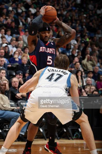 Josh Smith of the Atlanta Hawks looks to pass against Andrei Kirilenko of the Minnesota Timberwolves during the game on January 8 2013 at Target...