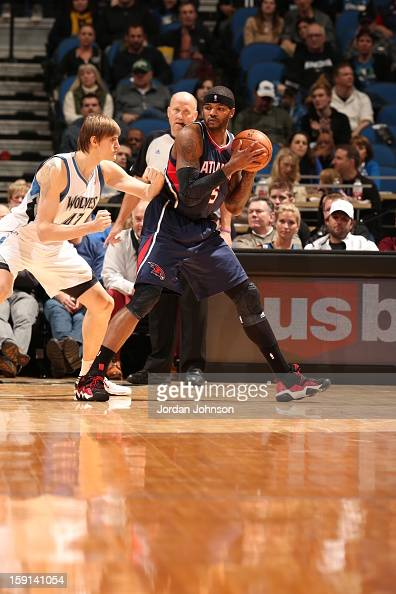Josh Smith of the Atlanta Hawks looks to pass the ball against Andrei Kirilenko of the Minnesota Timberwolves against during the game on January 8...