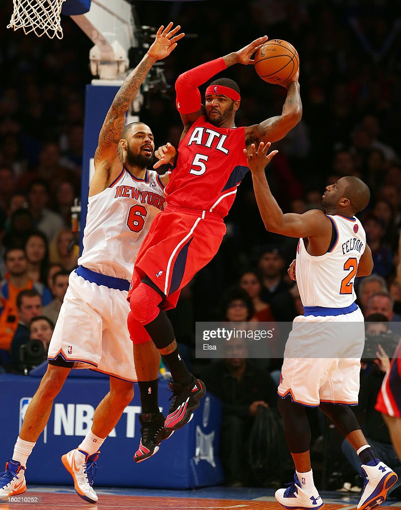 Josh Smith #5 of the Atlanta Hawks passes the ball as Tyson Chandler #6 and Raymond Felton #2 of the New York Knicks defend on January 27, 2013 at Madison Square Garden in New York City. The New York Knicks defeated the Atlanta Hawks 106-104.