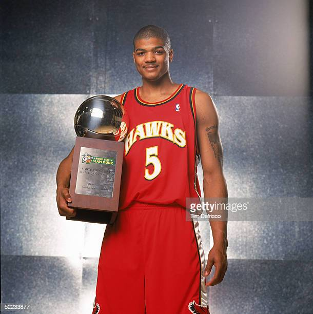 Josh Smith of the Atlanta Hawks poses with his trophy for winning the Sprite Rising Stars Slam Dunk contest during 2005 NBA AllStar Weekend at Pepsi...